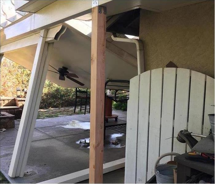 leaning patio cover holding up awning